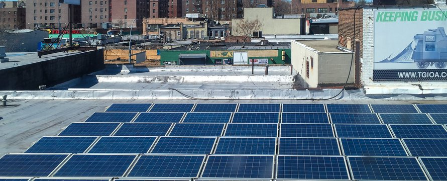 "Queens Street Scenes - Solar Panels on a"" (CC BY 2.0) by Steven Pisano"