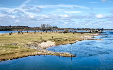 View from the railway bridge near Deventer, the Netherlands on the IJssel river and the Ossenwaard nature reserve with its newly created channel.