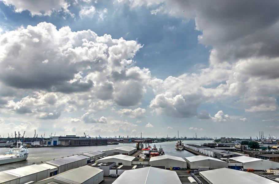 Rotterdam, The Netherlands, June 3, 2018: Sky with spectacular clouds over the harbour and industrial area of Merwe-Vierhavens