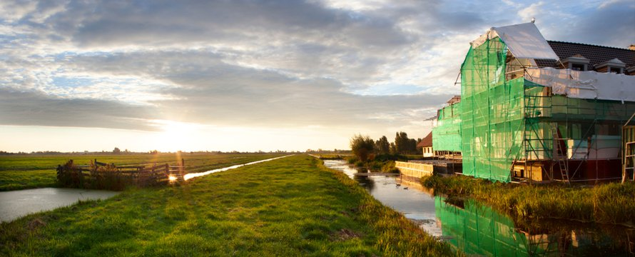Early morning construction site in a Dutch polder landscape