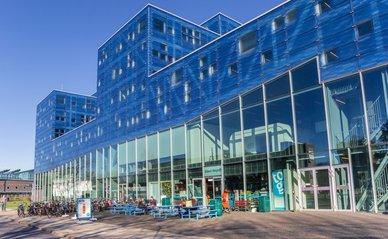 GRONINGEN, NETHERLANDS - FEBRUARY 15, 2019: Students enjoying the sun at the Groningen university campus