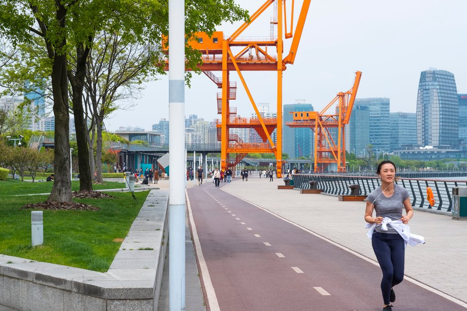 Riverfront path with bicycle track between Long Museum and the West Bund Arts Center in West Bund