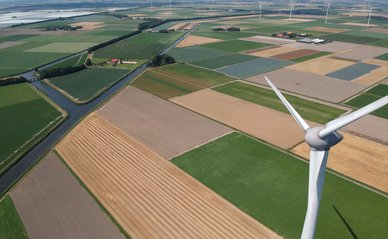 Drone photo of a large windmill with a total height of 198 meters with a shaft height of 135 meters. In the background, the wieringermeer polder.Photo taken at an altitude of 204 meters