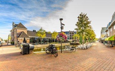 Hooftstraat, Alphen aan den Rijn, South Holland, Netherlands, August 23, 2019: Corner of Mandersloostraat, Hooftstraat and Aarkanaal with square and terraces