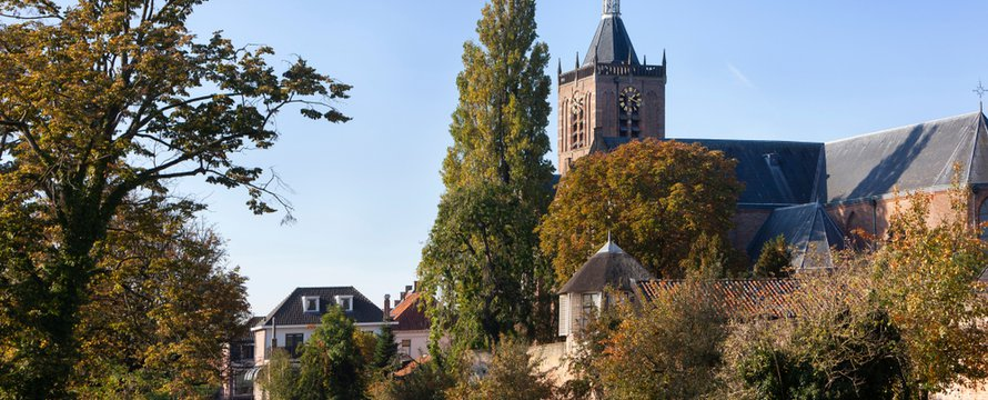 View on historic Vianen with church Grote Kerk and the old city wall in the Netherlands