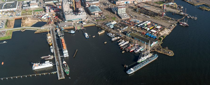 5 February 2020, Amsterdam Holland. Aerial view of NDSM wharf at the northside of river IJ. A harbour area with hotel, restaurant, residential apartments and construction of new high rise building.
