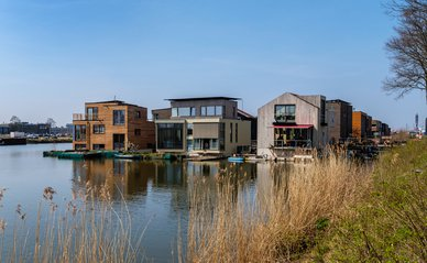 Amsterdam, April 2020. Neighborhood with wooden houses, floating on the water