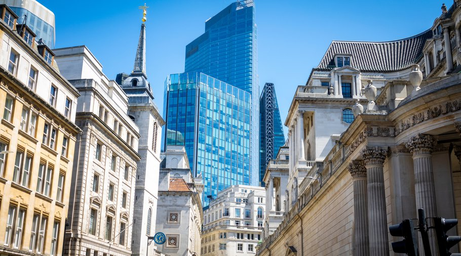 Looking up at City of London buildings, old and new