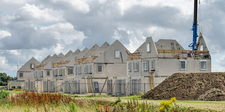 Numansdorp, The Netherlands, July 10, 2020: construction site of a row of terrace houses, with prefab concrete walls awaiting finishing under a dramatic sky