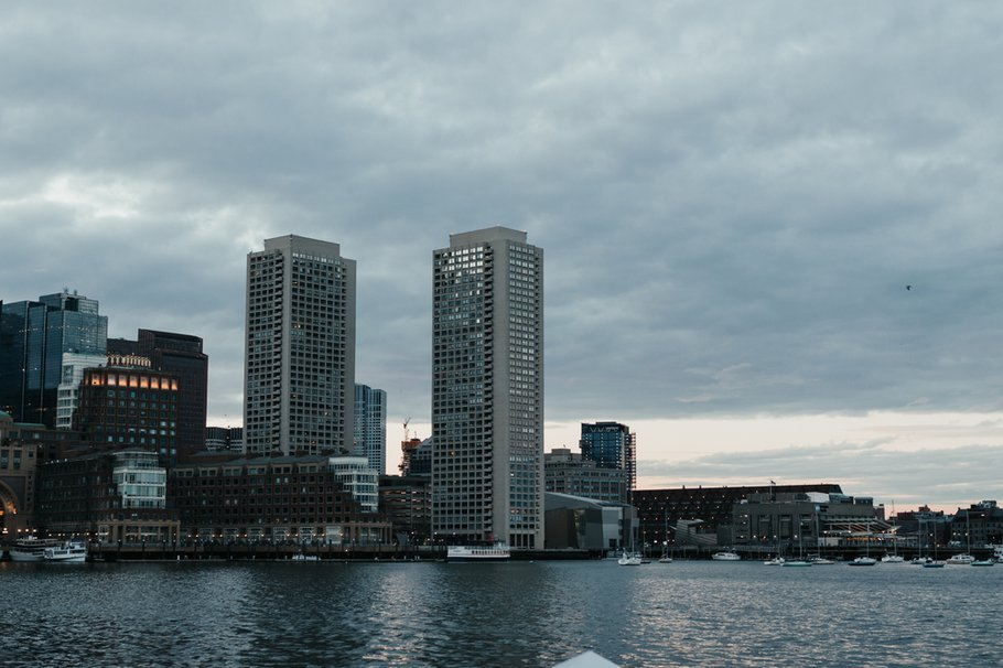 Cityscape over water on a cloudy day