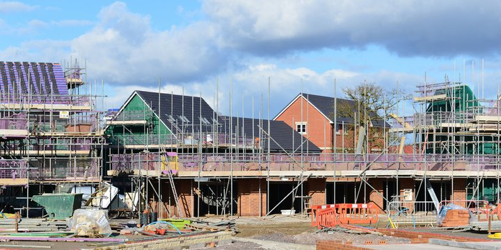 HILPERTON - FEB 21: View of a building site on Feb 21, 2015 in Hilperton, UK. The Wiltshire village is part of the UK's construction boom with the number of new homes being built up 10% since 2013.