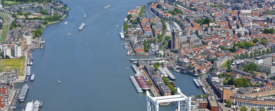 Aerial view of the city Dordrecht with the 'Grote Kerk' (Great Church) which had its origin in 1285, first catholic, later protestant. The tower was never finished. Flag of Dordrecht. The Netherlands
