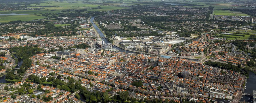 Aerial view of the city of Alkmaar. On the clear horizon a blue sky with cumulus clouds. Alkmaar is an old town in NOORD-HOLLAND, The Netherlands and known for it's KAASMARKT or cheese market.